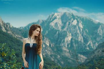 Beautiful girl enjoying  valley view nature over mountain landsc