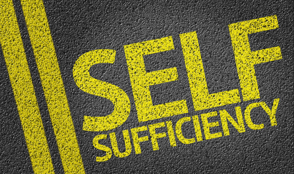 Self Sufficiency written on the road