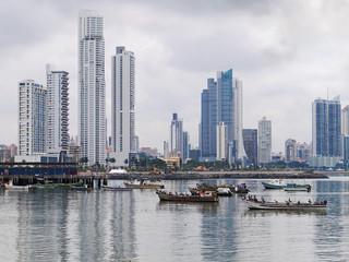 Fishing boats anchored with skyscrapers in Panama