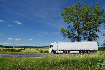 Fotobehang - Rural landscape with white truck on the road