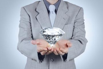 businessman hand holding 3d diamond as concept
