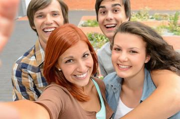 Group of student teenage friends taking selfie