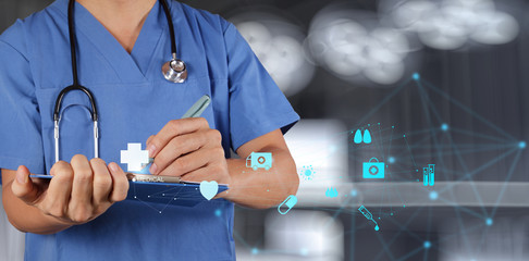 Medical Doctor working with note board as modern medical concept