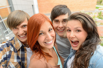Cheerful student friends taking selfie