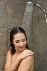 Beautiful woman cleaning skin in the shower