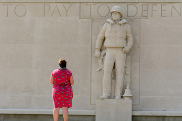 Lady paying respect at US World War Two Military cemetery