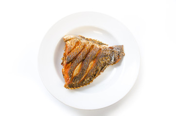 fried fish in plate white background isolated