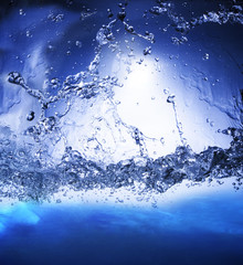 splashing blue water use as nature background ,backdrop and natu