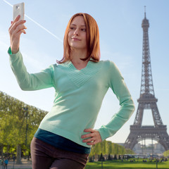 "Pretty girl taking a ""selfie"" with her smartphone in Paris, Fran"