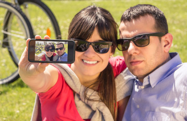 Couple in love taking a selfie photo on the park