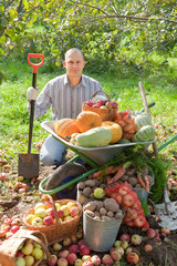 man with  harvest in garden