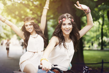 Funny time for hippie girls on bike