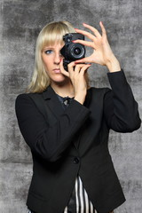 female photographer with SLR camera