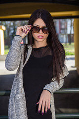 Attractive young woman in a urban fashion shot