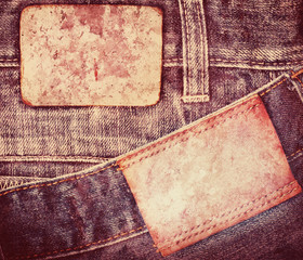 Grunge, stained leather jeans label sewed on jeans.