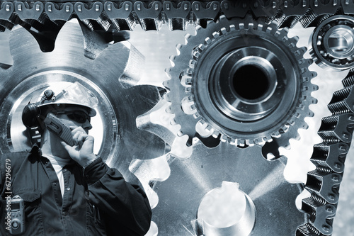 Wall mural engineer with gears mchinery and chains in the background
