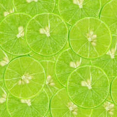 background of heap fresh green lime slices. Seamless pattern for