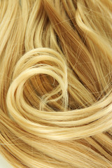 Curly blond hair close-up background
