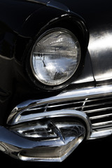 Classic sixties black car front headlight and grill