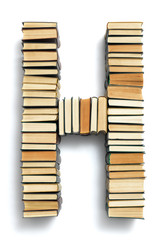 Letter H formed from the page ends of books