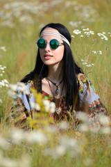 hippie girl on a flowering field