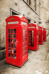 Wall Mural - rote Telefonzellen in London mit antiker Textur
