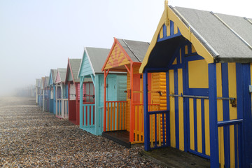 Beach huts on the foggy day