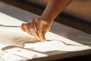 Sand animation. Hands girls draw sand