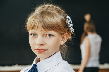 young girl in classroom. School. fashion