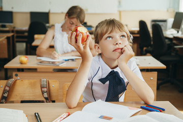 schoolkids work at lesson