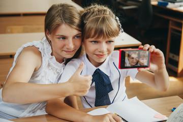 Two girl. Selfie. School
