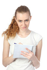 The young woman writes to a writing-book