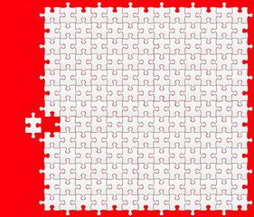 grand puzzle avec fond rouge et pièce déplacée