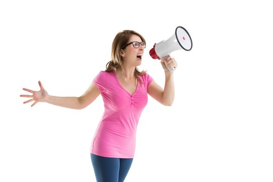 Young woman shouting into bullhorn