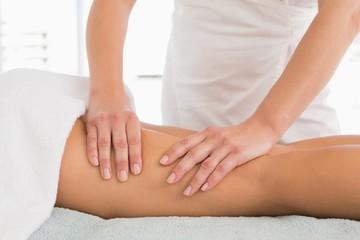 Close-up of a woman receiving leg massage