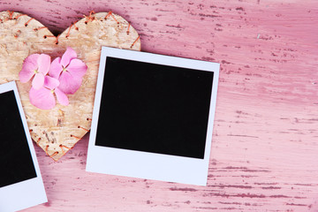 Blank old photos and decorative heart on color wooden