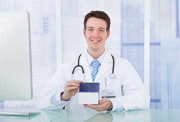 Doctor Holding Medicine Box In Hospital