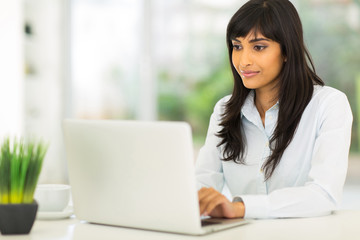indian businesswoman using computer