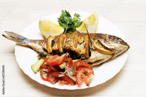 "Cooked fish sea bream fish with lemon, parsley,garlic."" Stockfotos ..."