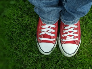Red shoes into green grass