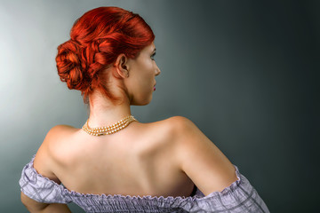 Young woman with elegant braided hairstyle