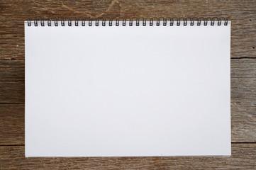 open sketchbook or notebook on wooden background