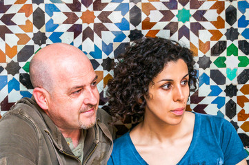 couple sitting with Arabic mosaic