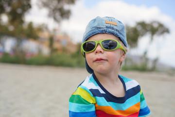 Boy in denim hat and sunglasses