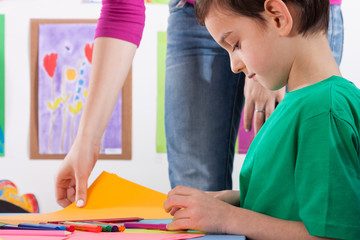 A young boy prepares the card