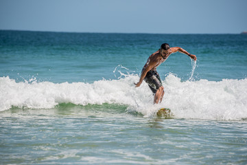 Surfer at Ilha Grande, Lopes Mendes beach. Funny. Brazil Rio do