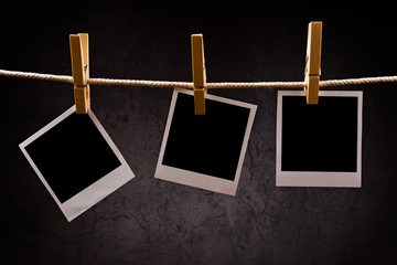 Photography paper with instant photo frames attached to rope wit