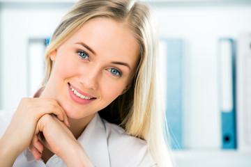 Close up portrait of smiling business woman