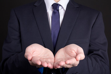 business man holding hand presenting product