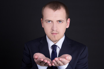 business man presenting something on his hand